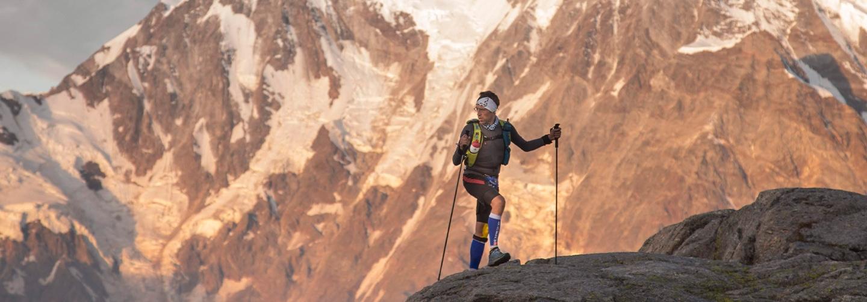 Runner climbing to Monte Moro pass